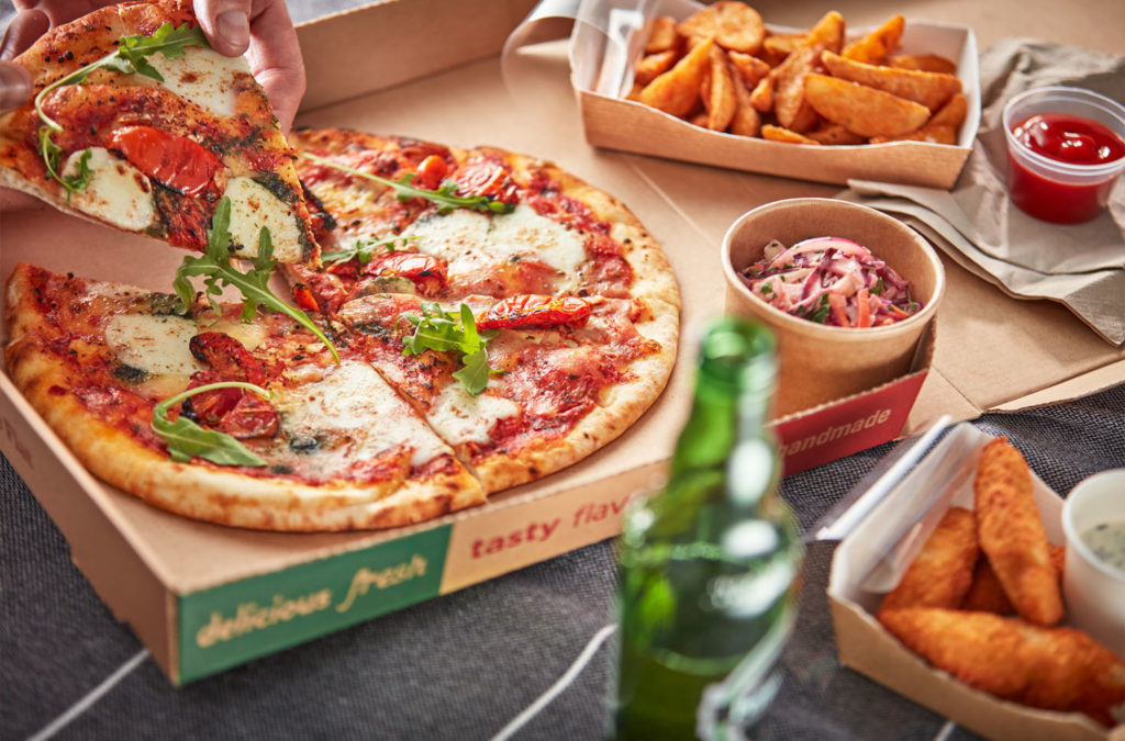 Pizza and potato wedges that have been kept warm with Flexeserve's true hot-holding