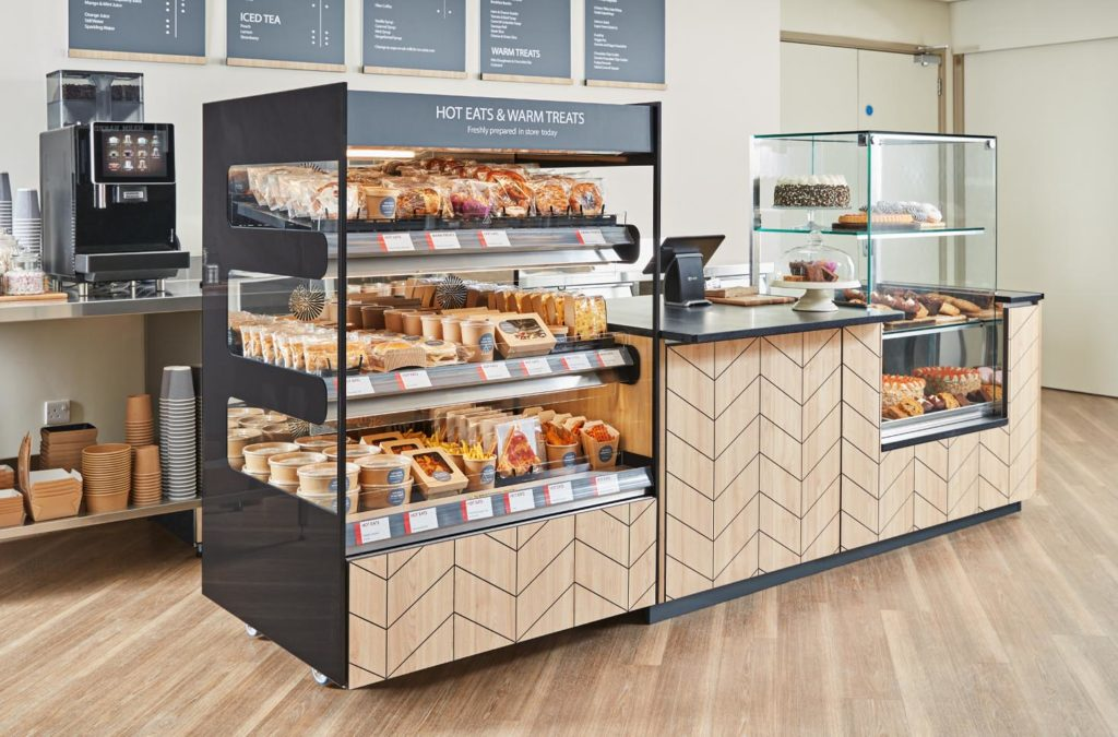 A large 3-tier Flexeserve Zone unit hot-holding a variety of foods at end of counter in a cafe